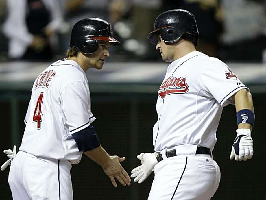 Cleveland Indians' Trevor Crowe (4) greets teammate Matt LaPorta after LaPorta's two-run home run in the sixth inning of a baseball game against the Oakland Athletics, Thursday, Aug. 26, 2010, in Cleveland. The Indians won 3-2. Photo: Mark Duncan, AP