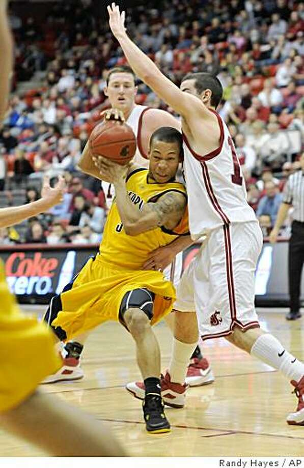 California's Jerome Randle, left, drives against Washington State's Aron Baynes, right, during the first half of an NCAA college basketball game on Thursday, Jan. 8, 2009, at Friel Court in Pullman, Wash. Photo: Randy Hayes, AP
