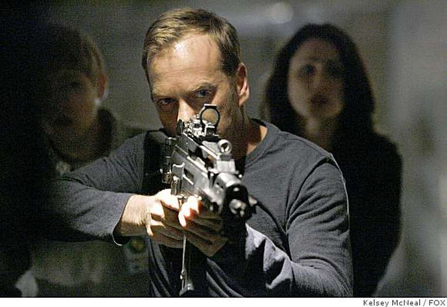 24:  Jack (Kiefer Sutherland) hunts down the terrorists who have infultrated CTU in the 24. Photo: Kelsey McNeal, FOX