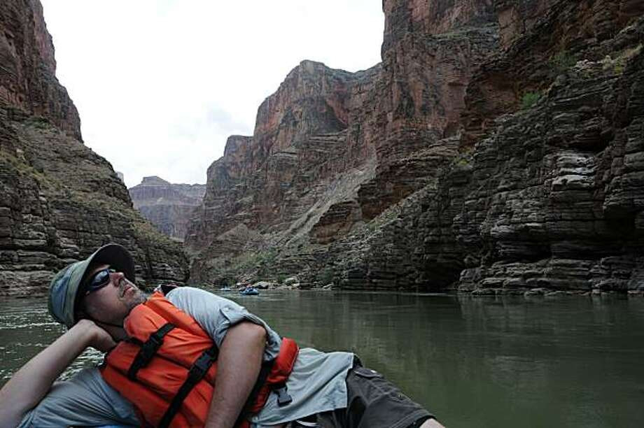 Paul Harrar of Nevada City relaxes on the raft in the Grand Canyon. Photo: .