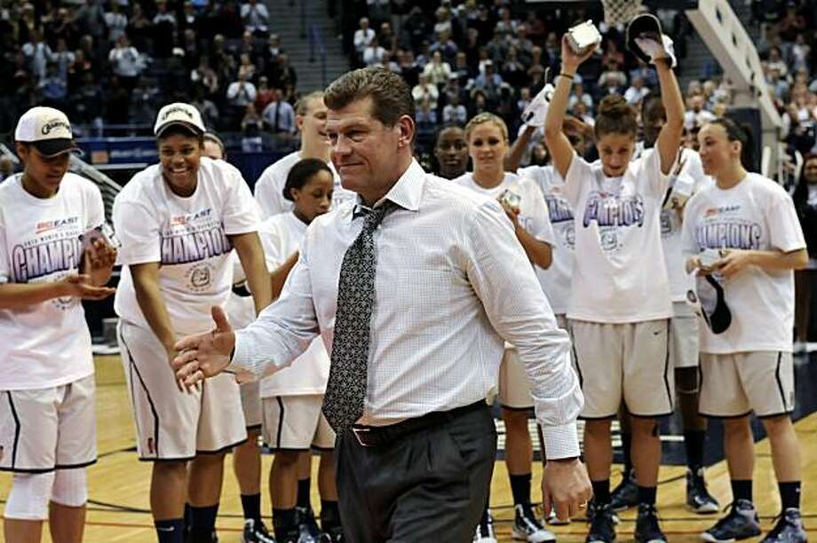 Connecticut coach Geno Auriemma walks to receive an award after his team defeated West Virginia 60-32 in an NCAA college basketball game in Hartford, Conn., Tuesday, March 9, 2010, to win the Big East women's tournament. Photo: Bob Child, AP