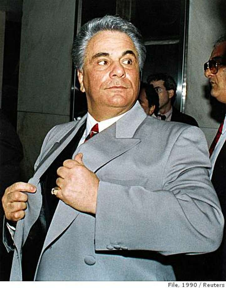 Former Mafia boss John Gotti, who has been ill with head and neck cancer, died at a prison hospital while serving a life sentence in Springfield, Missouri, June 10, 2002. He was 61. He is shown arriving at New York State Supreme Court in this February 9, 1990 file photo. Photo: File, 1990, Reuters