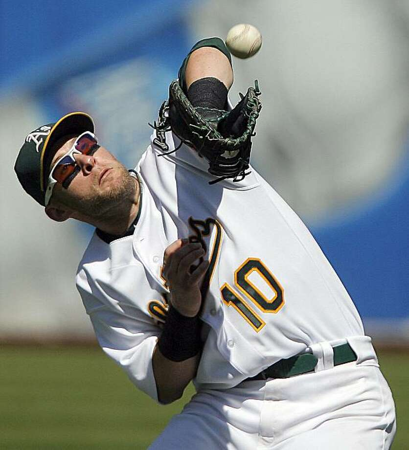 Oakland Athletics' first baseman Daric Barton catches Tampa Bay Rays' Evan Longoria's pop-up in the seventh inning of a baseball game in Oakland, Calif., Sunday, Aug. 22, 2010. Photo: John Storey, AP