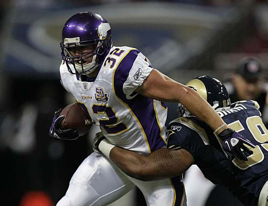Minnesota Vikings running back Toby Gerhart, (32), runs against St. Louis Rams linebacker Larry Grant, (59), during the first quarter of a preseason NFL football game Saturday, Aug. 14, 2010, in St Louis. Photo: Jeff Roberson, AP