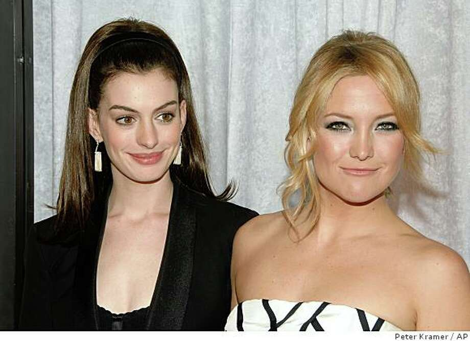 "Actors Anne Hathaway, left, and Kate Hudson attend the premiere of ""Bride Wars"" in New York on Monday, Jan. 5, 2009.  (AP Photo/Peter Kramer) Photo: Peter Kramer, AP"