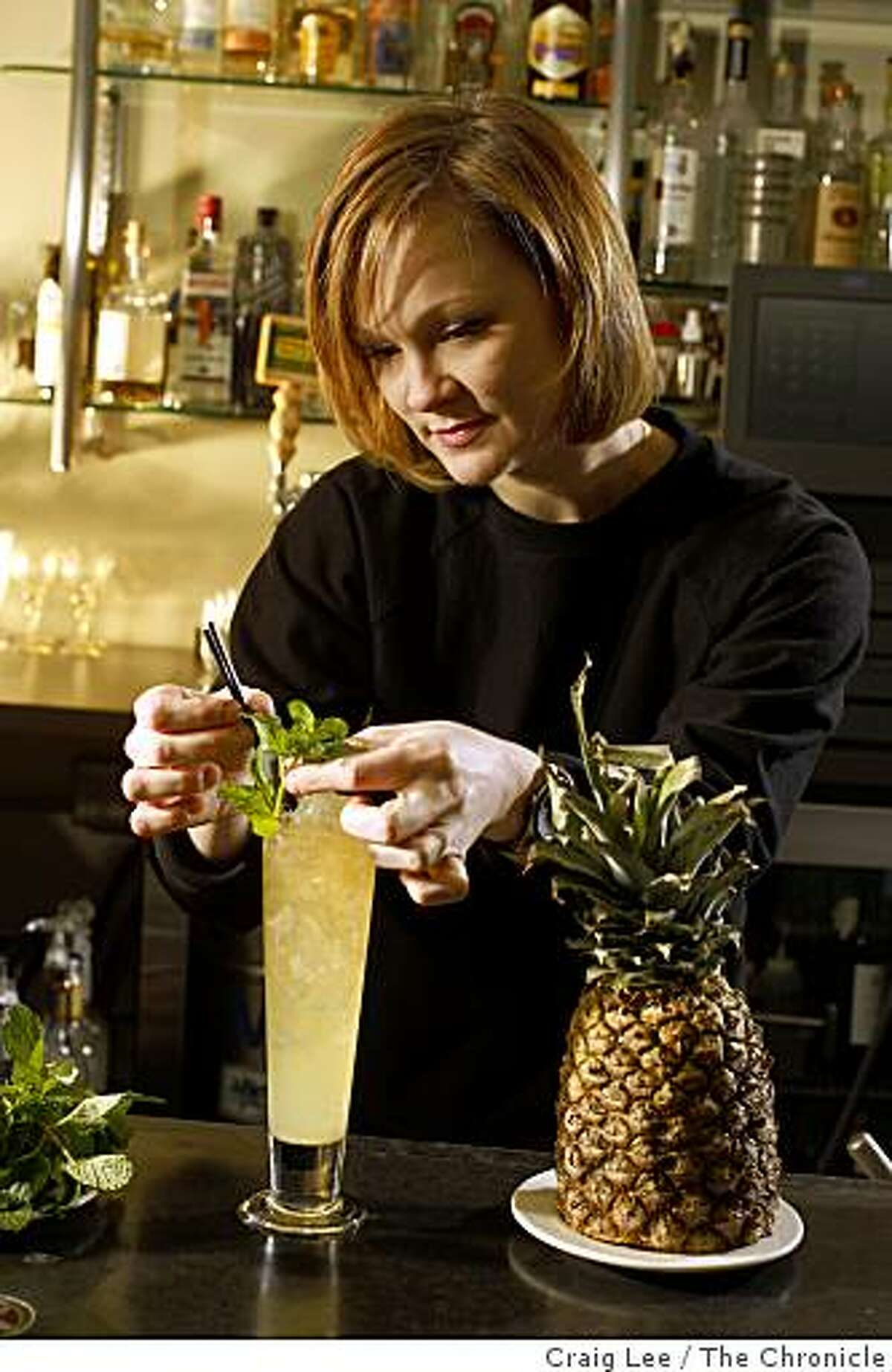 Brooke Arthur, making a cocktail drink, called Strange Brew, where beer is one of the ingredients at Range restaurant in San Francisco, Calif., on January 7, 2009.