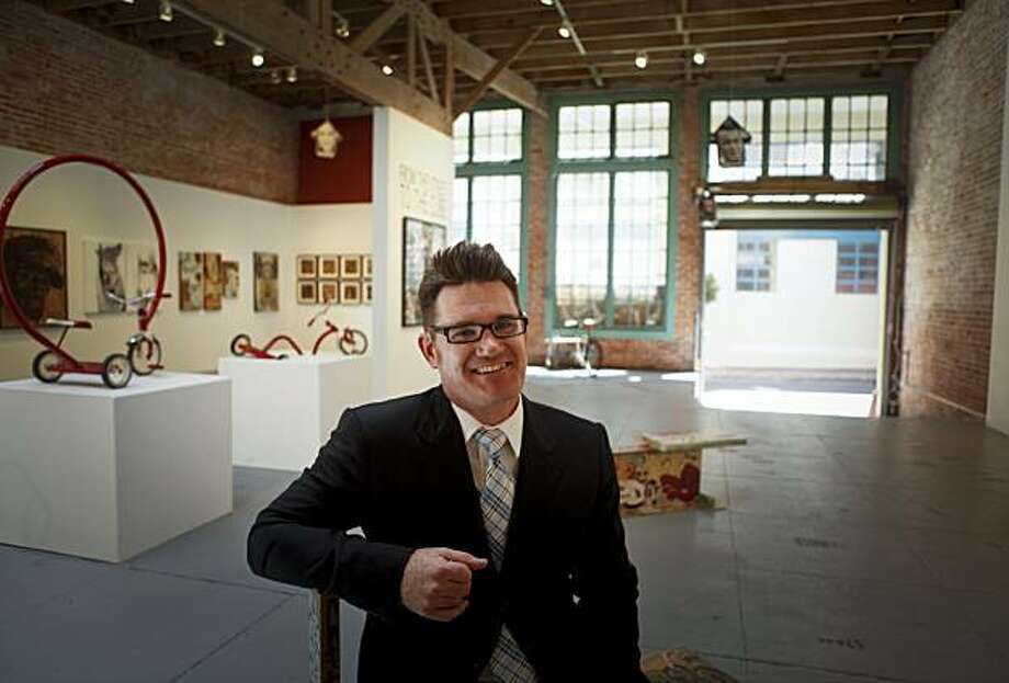 Justin Giarla is seen on Wednesday, Aug. 18, 2010 in his recently opened art gallery in a former auto smog shop at 941 Geary Blvd. in San Francisco, Calif.. The gallery is aptly named 941Geary. Photo: Russell Yip, The Chronicle