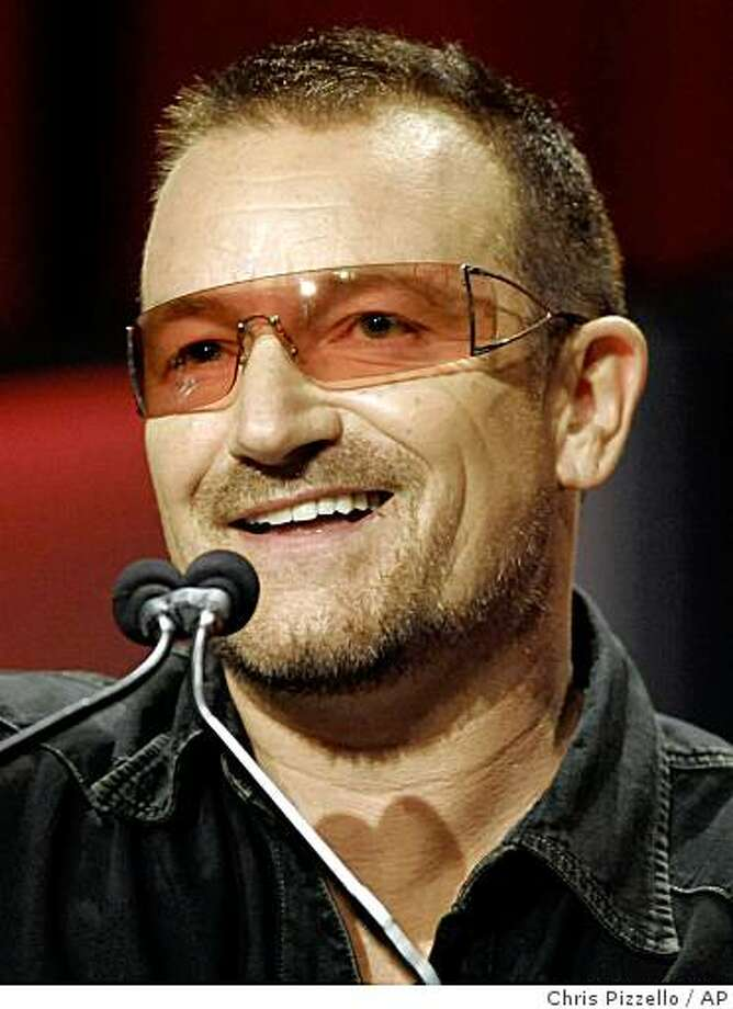 ** FILE ** In this Oct. 22, 2008 file photo, Bono addresses the audience at The Women's Conference in Long Beach, Calif. (AP Photo/Chris Pizzello, file) Photo: Chris Pizzello, AP