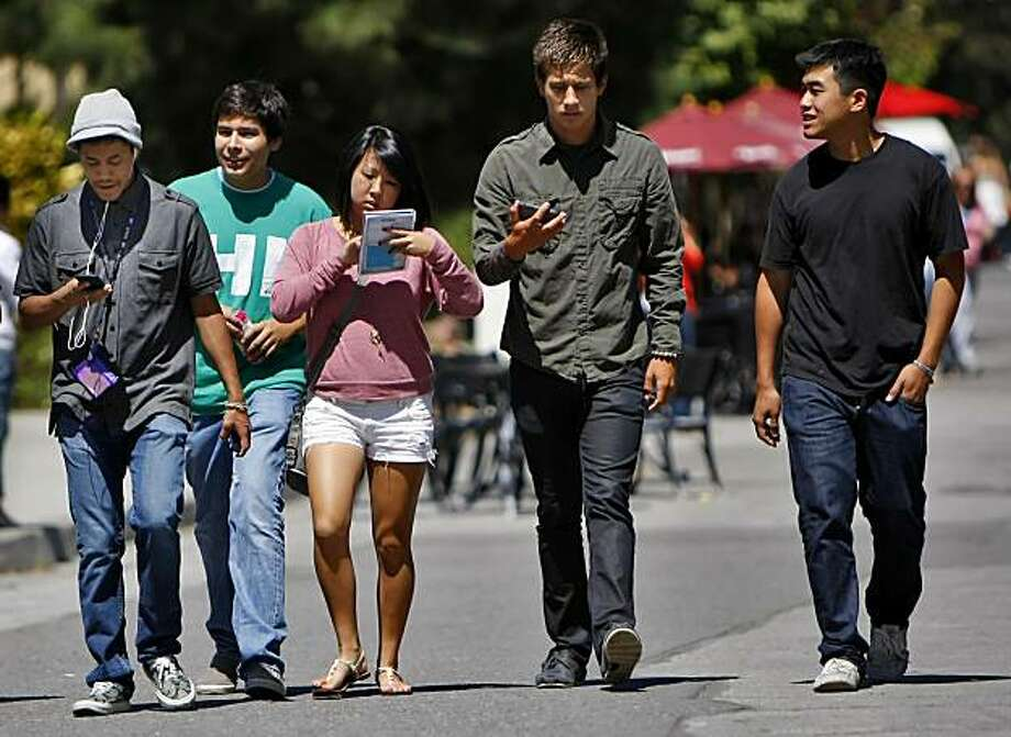 New freshman Arnold Shir,left,  Jesus Navarro, Kimi Takeda, Marcus Fernandez, and Legend Nguyen  map out where their classes in preparation of the first day of school, on the campus at San Francisco State University, Monday August 23, 2010, in San Francisco, Calif. Photo: Lacy Atkins, The Chronicle