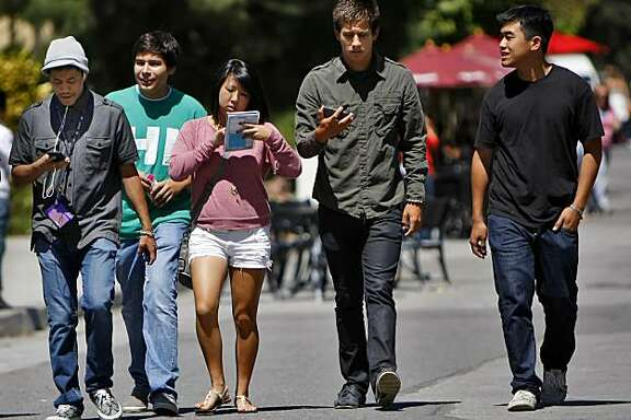 New freshman Arnold Shir,left,  Jesus Navarro, Kimi Takeda, Marcus Fernandez, and Legend Nguyen  map out where their classes in preparation of the first day of school, on the campus at San Francisco State University, Monday August 23, 2010, in San Francisco, Calif.