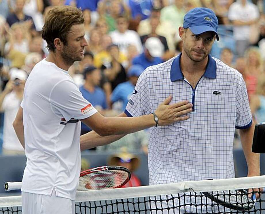 Mardy Fish, from Tampa, Fla., left, consoles Andy Roddick, from Austin, Texas, after Fish defeated Roddick 4-6, 7-6 (3), 6-1, in a match at the Cincinnati Masters tennis tournament, Saturday, Aug. 21, 2010, in Mason, Ohio. Photo: Al Behrman, AP