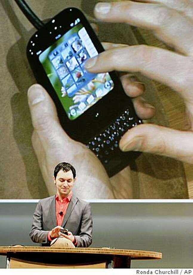 Palm Inc. Senior Director of Human Interface and User Experience Matias Duarte demonstrates the Palm Web OS platform on the new Palm Pre handset during the International Consumer Electronics Show  on Thursday in Las Vegas. Photo: Ronda Churchill, AP