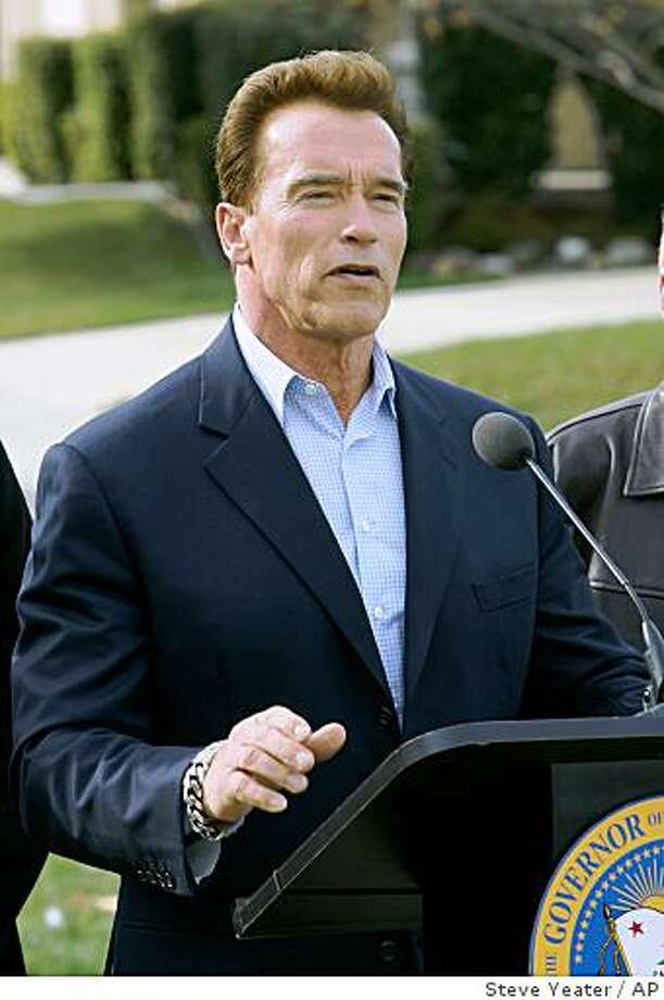 California Gov. Arnold Schwarzenegger speaks about delays in funding for infrastructure projects due to the state budget crisis during a news conference near a Sacramento River levee in disrepair in Sacramento, Calif., on Tuesday, Dec. 23, 2008. (AP Photo/Steve Yeater) Photo: Steve Yeater, AP