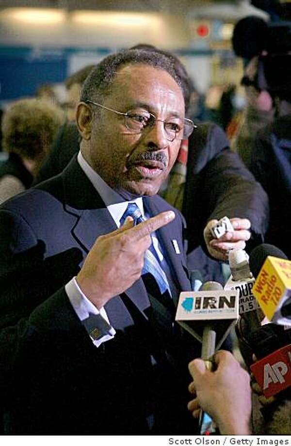CHICAGO - JANUARY 05:  Roland Burris, the former Illinois Attorney General chosen by Illinois Governor Rod Blagojevich to fill the U. S. Senate seat vacated by President-Elect Barack Obama, speaks to the media as he prepares to catch a flight to Washington, D.C. at Midway Airport January 5, 2009 in Chicago, Illinois. Opponents say they will fight Burris' appointment because Blagojevich was recently accused by federal authorities of offering to sell the vacancy to the highest bidder.  (Photo by Scott Olson/Getty Images) Photo: Scott Olson, Getty Images