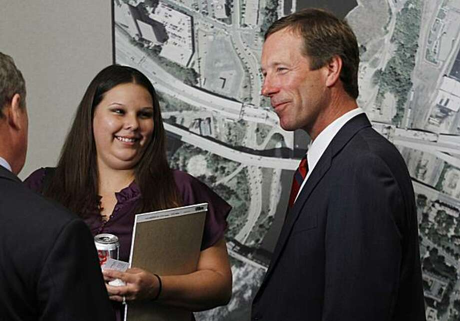 Chris Messerly, right, of the law firm Robins, Kaplan, Miller and Ciresi and I-35W bridge collapse litigant Anne Engebretsen talk after a press conference announcing a $54.2 million settlement between URS Corporation and victims and families of the collapse in Minneapolis Monday, Aug. 23, 2010. Engebretsen's mother died in the collapse. She  got married a month ago without her mother to see it. Photo: Andy King, AP
