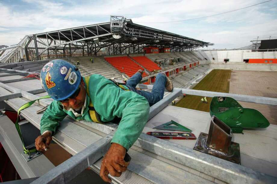 Reinaldo Tinoco makes a mark on a piece of steal before welding a support while working at the new Houston Dynamo BBVA Compass Stadium. Photo: Michael Paulsen, Houston Chronicle / © 2012 Houston Chronicle