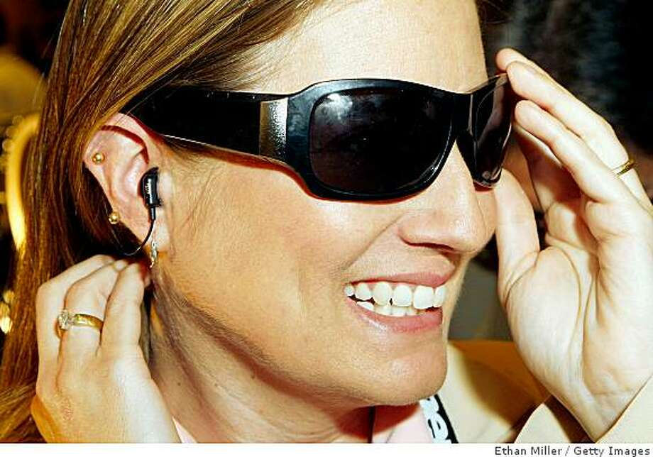 Liz Kerton of Step Labs displays TriSpecs Bluetooth sunglasses during a press event at the Venetian for the 2009 International Consumer Electronics Show January 6, 2009 in Las Vegas, Nevada. Photo: Ethan Miller, Getty Images