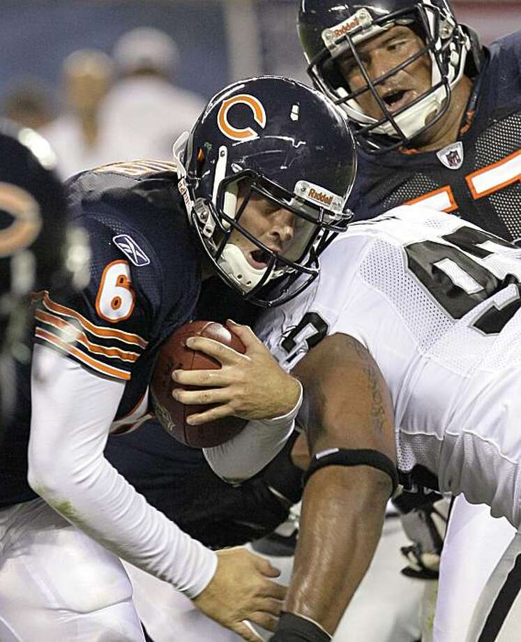 Chicago Bears quarterback Jay Cutler (6) is stopped by Oakland Raiders defensive tackle Tommy Kelly (93) after a gain  in the first half of a preseason NFL football game in Chicago, Saturday, Aug. 21, 2010. Photo: Charles Rex Arbogast, AP