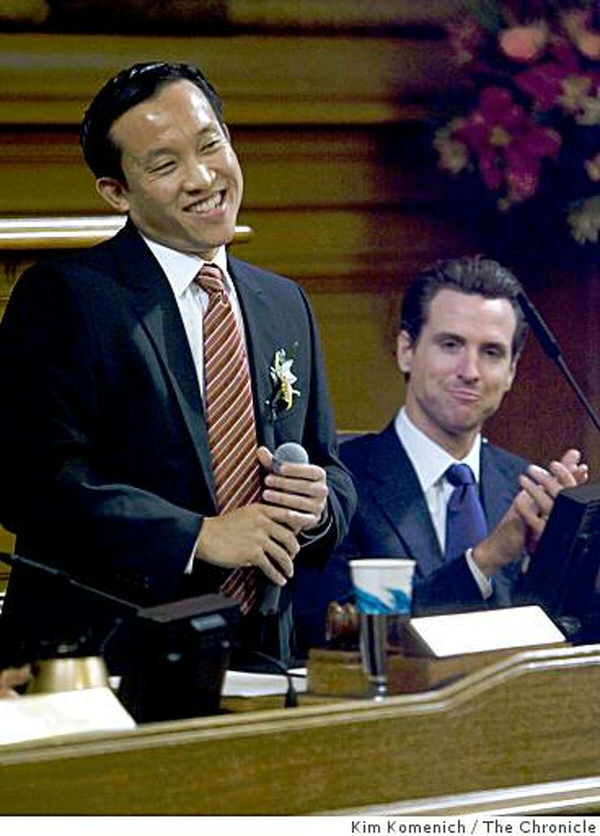 Supervisor David Chiu, left, is elected president of the San Francisco Board of Supervisors in the board's San Francisco, Calif., chambers on Thursday Jan. 8, 2009. San Francisco Mayor Gavin Newsom is at right.