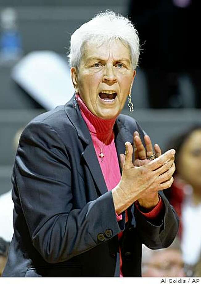 ** FILE ** This is an April 2, 2008 file photo showing North Carolina State women's basketball coach Kay Yow encouraging her team during the first half of a semifinal basketball game of the women's NIT against Michigan State,  in East Lansing, Mich. North Carolina State is planning an announcement on the status of Hall of Fame women's basketball coach Kay Yow, who has missed the past four games due to health issues related to her fight against cancer.  School spokesman Mark Kimmel said the school would have an update Tuesday afternoon Jan. 6, 2009.  (AP Photo/Al Goldis, File) Photo: Al Goldis, AP