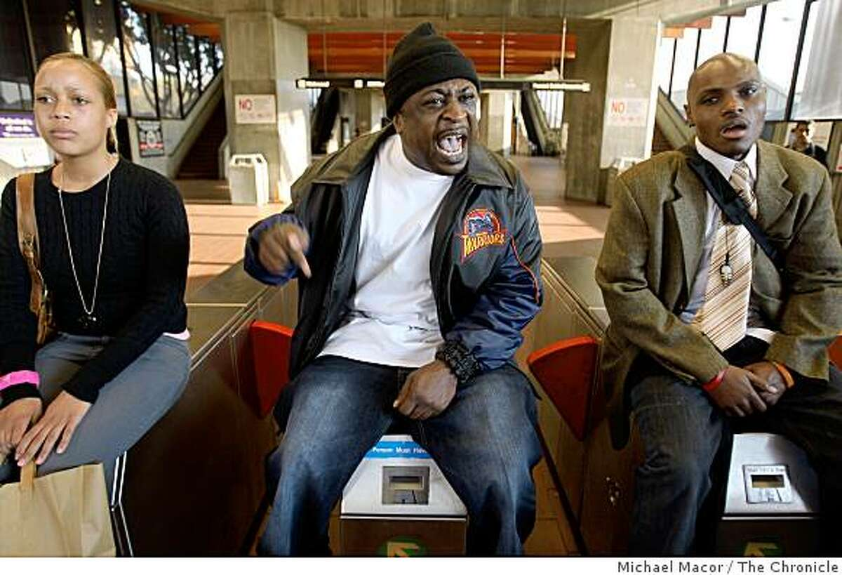 Mandingo, (center) and others managed to shut down the Fruitvale BART station, on Wednesday Jan. 7, 2009, in Oakland, Calif., as hundreds protested the shooting death of Oscar Grant by a BART police officer.
