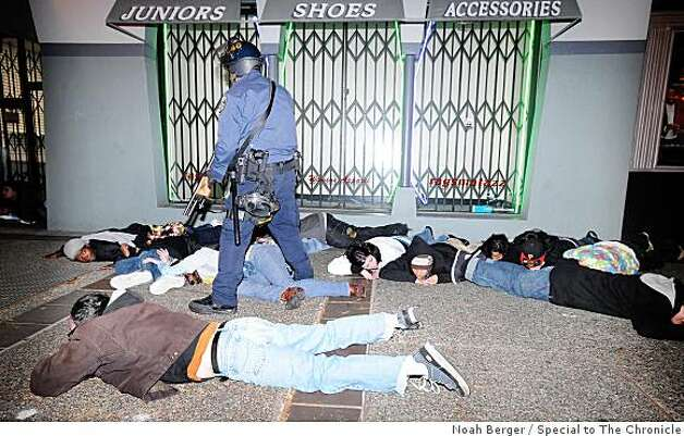 Protesters lie on their stomachs as they get arrested following hours of destruction in Oakland, Calif., on Wednesday, Jan. 7, 2009. Photo: Noah Berger, Special To The Chronicle