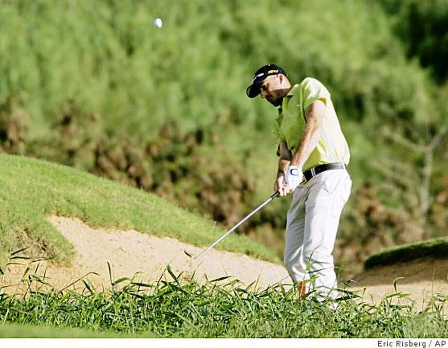 Geoff Ogilvy chips the ball onto the 18th green of the Plantation Course during the first round of the Mercedes-Benz Championship in Kapalua, Hawaii, Thursday, Jan. 8, 2009. Ogilvy leads the tournament after shooting a 6-under-par 67. Photo: Eric Risberg, AP