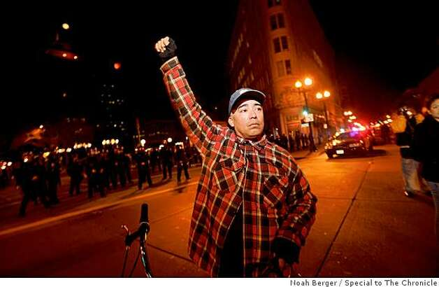 Javier Reyes protests the BART police shooting of an unarmed man, on Wednesday, Jan. 7, 2006, in Oakland, Calif. Photo: Noah Berger, Special To The Chronicle