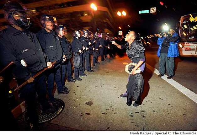 A protester yells at police officers in downtown Oakland, Calif. on Wednesday, Jan. 7, 2009. Photo: Noah Berger, Special To The Chronicle