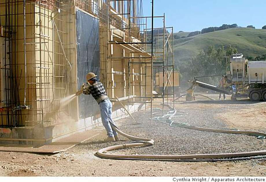 "actual application of pise material using shotcrete (or ""gunite') technology Photo: Cynthia Wright, Apparatus Architecture"