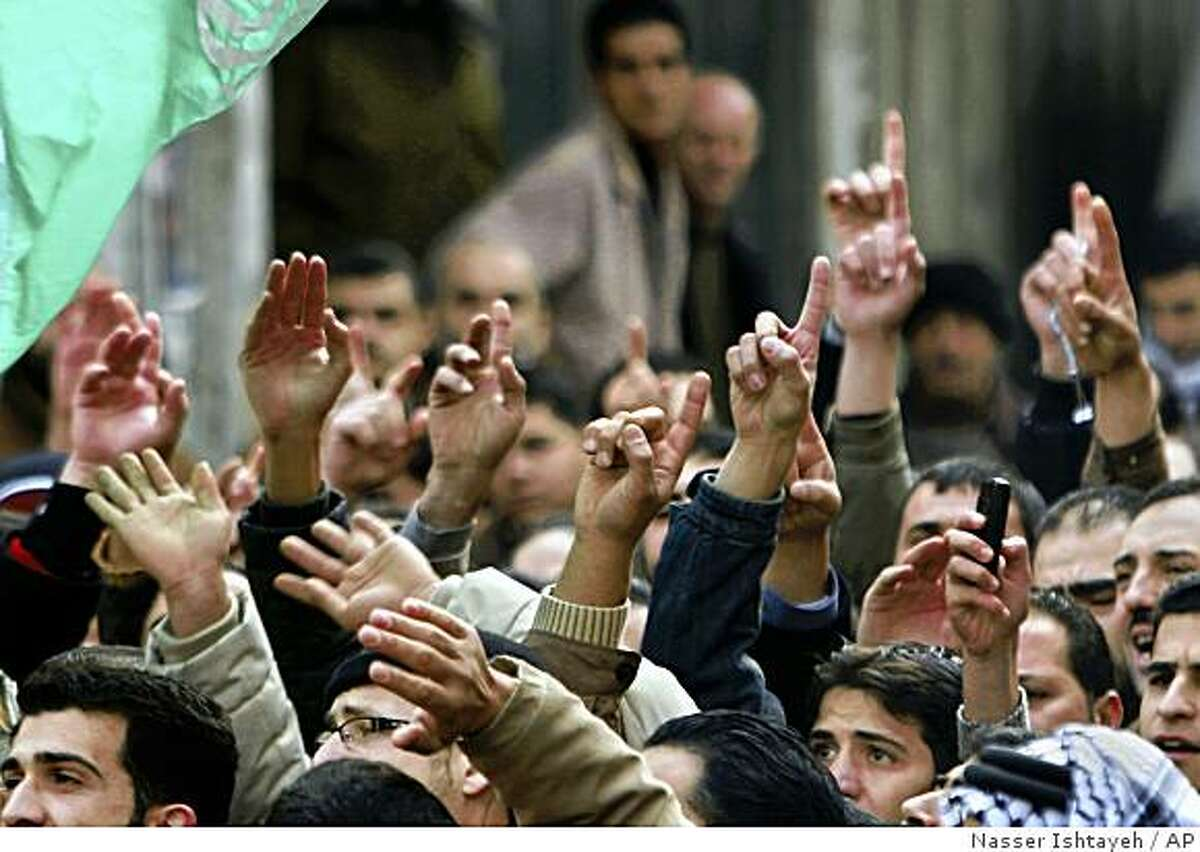 Palestinian Hamas supporters chant slogans as they protest against Israel's military operation in Gaza, in the center of the West Bank city of Nablus, Friday, Jan. 2, 2009. Israel showed no sign of slowing a blistering seven-day offensive against Gaza's Hamas rulers, destroying homes of more than a dozen of the group's operatives Friday and bombing one of its mosques a day after a deadly strike killed a prominent Hamas figure. (AP Photo/Nasser Ishtayeh)