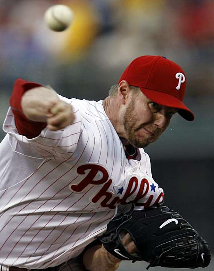 Philadelphia Phillies starting pitcher Roy Halladay throws against the Washington Nationals in the first inning of a baseball game in Philadelphia, Friday, Aug. 20, 2010. The Phillies won 1-0. Photo: Matt Rourke, AP