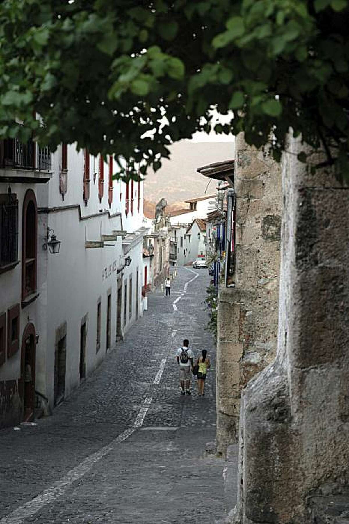 Taxco, Guerrero, Mexico - Steep, narrow streets surrounded by hills.