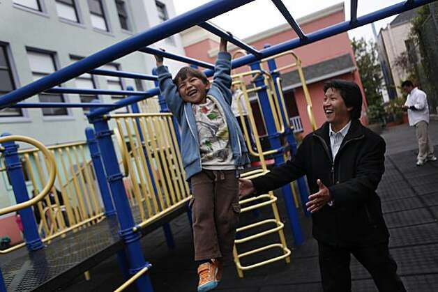 Jack Hsieh (left), 5, swings on the monkey bars at Chinese Immersion School at De Avila as his father, Tom Hsieh (right), Vice President of Fundraising (a PTA position) and is on the School Site Council (an elected position), spots him in San Francisco, Calif. on Friday August 20, 2010. Photo: Lea Suzuki, The Chronicle
