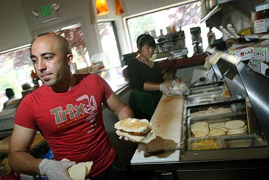 Owner of Ike's Place at 3506 16th St in San Francisco, Ike Shehadeh works the sandwich line preparing sandwiches that are both vegan and vegetarian as well as the traditional meat sandwiches with wild names like the popular Name of the girl I'm Dating, Chicken Breast with honey mustard, Avocado, pepper jack cheese on a bun of your choice  Photographed in San Francisco Calif,Tuesday April 22, 2008. Photo By Lance Iversen / San Francisco Chronicle Photo: Lance Iversen, San Francisco Chronicle