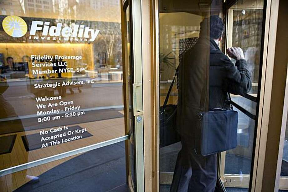A man exits a Fidelity branch in New York, U.S., on Tuesday, Feb. 24, 2009. Fidelity Investments, Charles Schwab Corp. and other 401(k) account managers say most clients rode out the worst months of the stock market slump without changing weekly contributions or moving to more conservative money-market or bond funds. Photographer:  JB Reed/Bloomberg News Photo: JB Reed, Bloomberg News