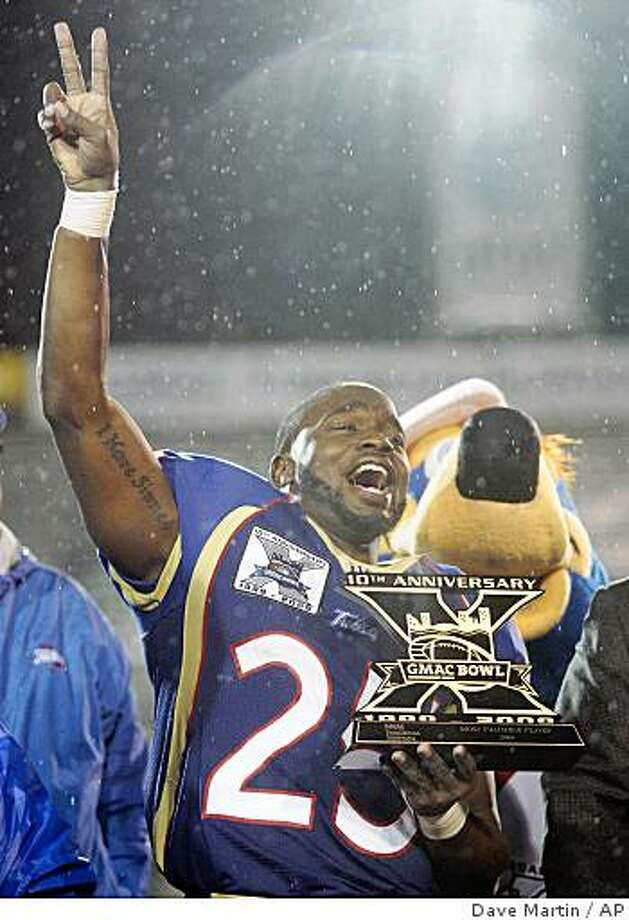 Tulsa running back Tarrion Adams holds his most valuable player trophy following Tulsa's 45-13 win over Ball State in the GMAC Bowl in Mobile, Ala., Tuesday, Jan. 6, 2009. Photo: Dave Martin, AP