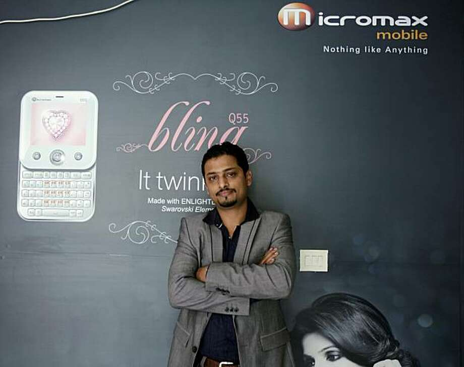 Vikas Jain, one of the founders and business director of Micromax Informatics Ltd., poses for a portrait in the Micromax offices in  Gurgaon, India, on Wednesday, Aug.11, 2010. Jain drew inspiration for the company's first phone from a line of Indian villagers standing in the midday heat to get their cell phones charged by a man with a car battery mounted on a bicycle. Their homes had no electricity. Photographer: Adeel Halim/Bloomberg *** Local Caption *** Vikas Jain Photo: Adeel Halim, Bloomberg