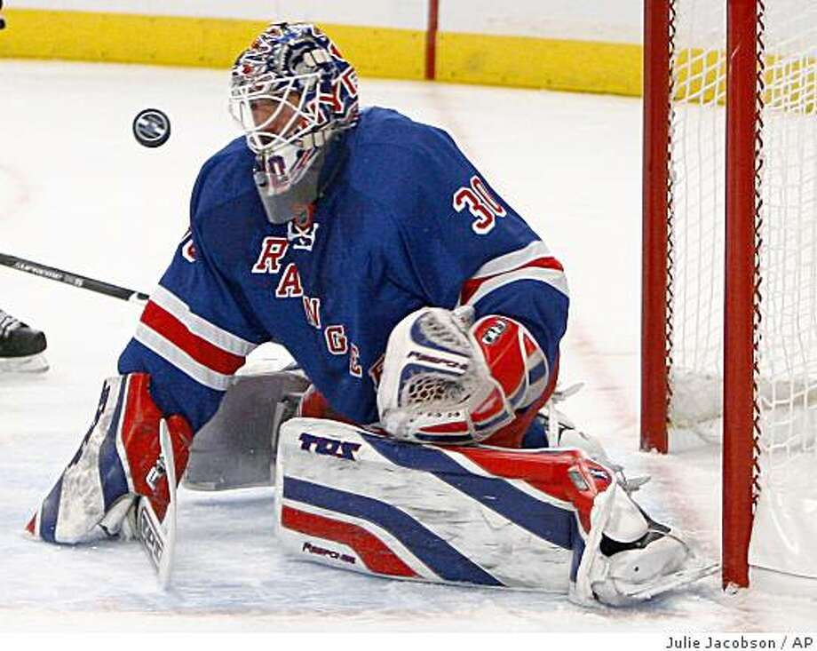 New York Rangers goalie Henrik Lundqvist blocks a shot on goal in the first period against the Pittsburgh Penguins during an NHL hockey game Monday, Jan. 5, 2008, at Madison Square Garden in New York. (AP Photo/Julie Jacobson) Photo: Julie Jacobson, AP