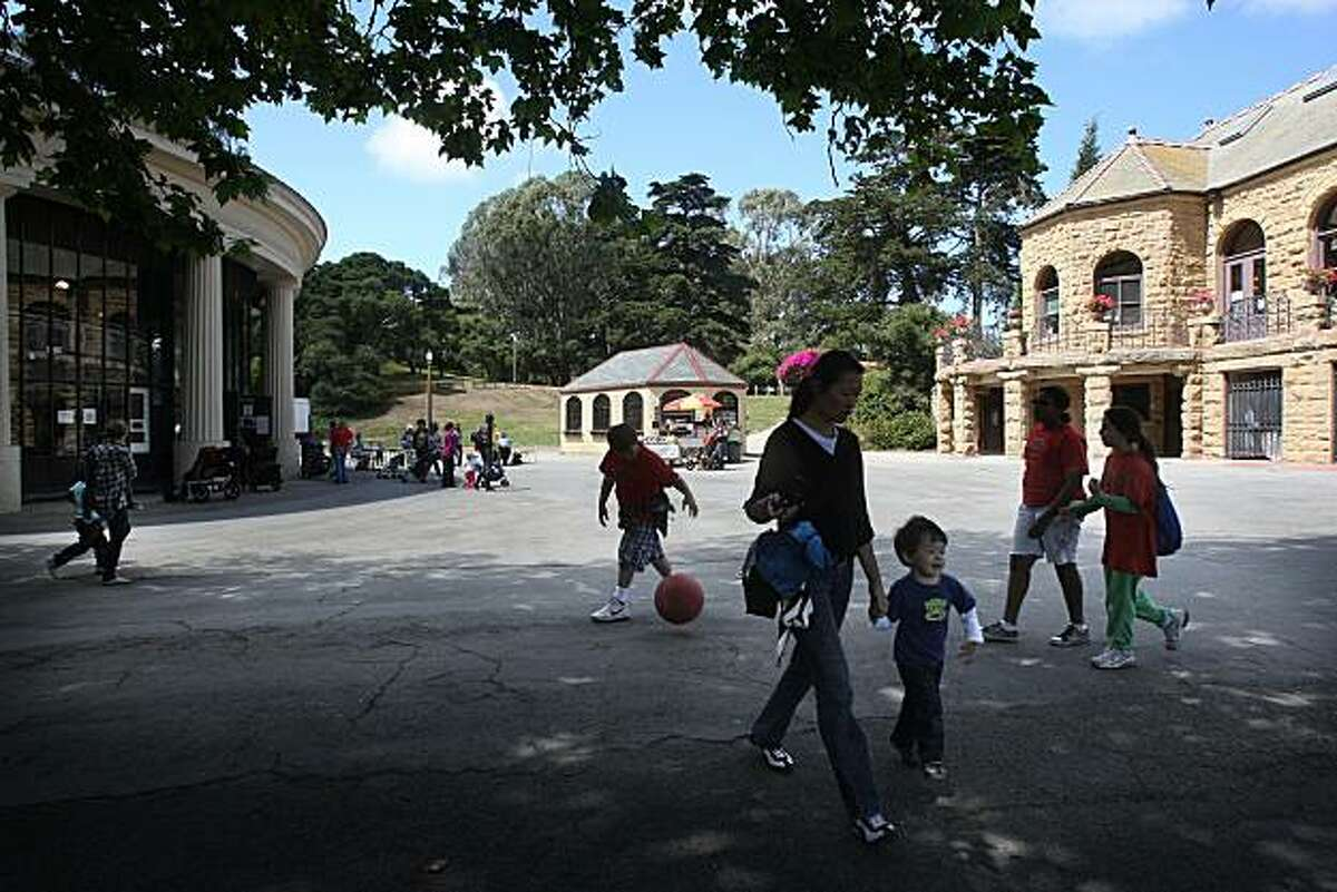 Visitors in the plaza area at Children's Playground, tucked between the Sharon Arts Studio and the carousel, at Golden Gate Park in San Francisco, Calif., on Wednesday, August 18, 2010. The plaza will soon be renovated and the project will include a new gateway into the public playground being the first in the United States established in 1887.