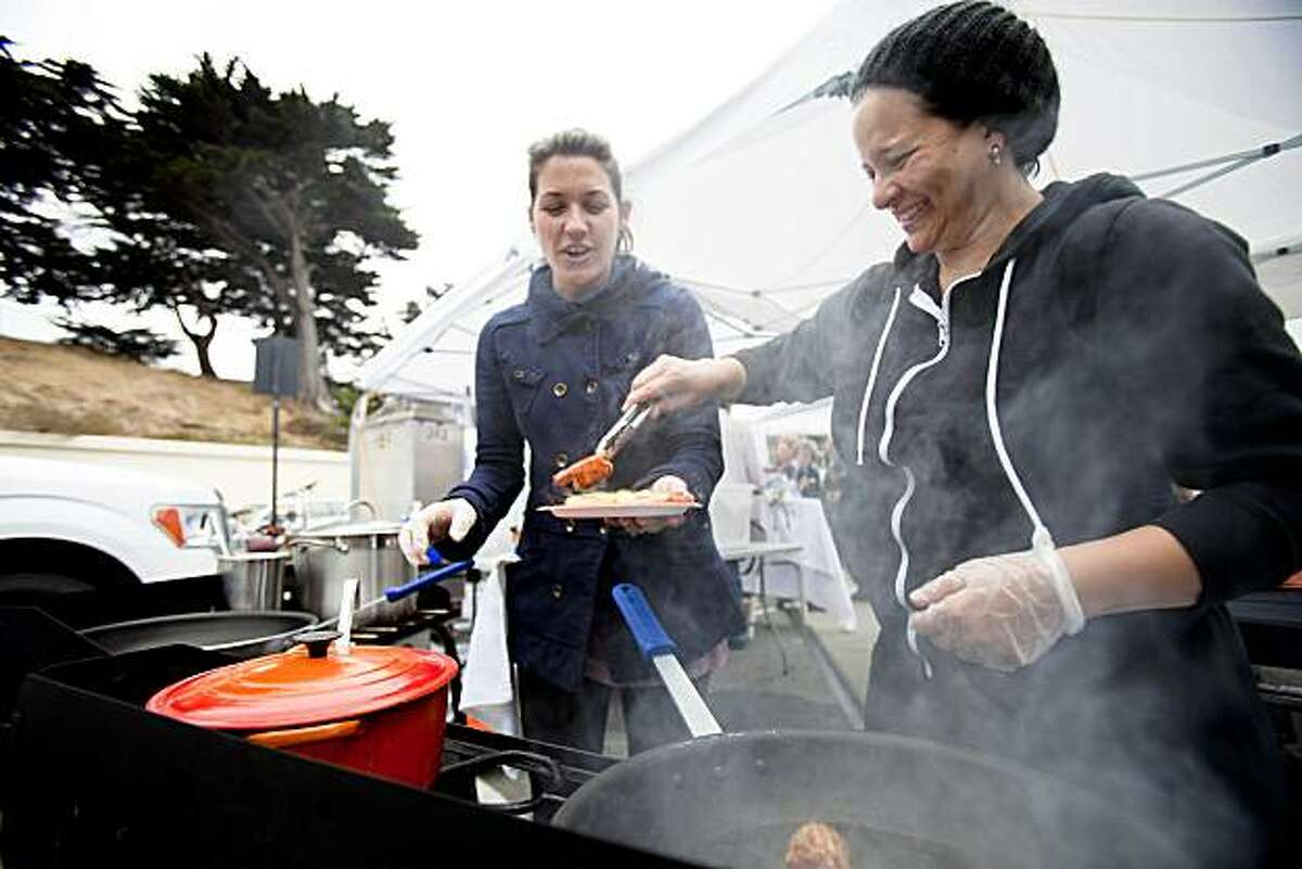 Christina Aviles assembles a shrimp toasties held by friend Libby Truesdell during the weekly Off The Grid food event held at Fort Mason Center in San Francisco, Calif. on Friday, Aug. 13, 2010. The food truck, started by Aviles and Aviles' partner Jessica Phadungsilp, specializes in variety of ethnic foods, from chicken curry to Thai spring rolls and banana coconut ice cream sandwiches.