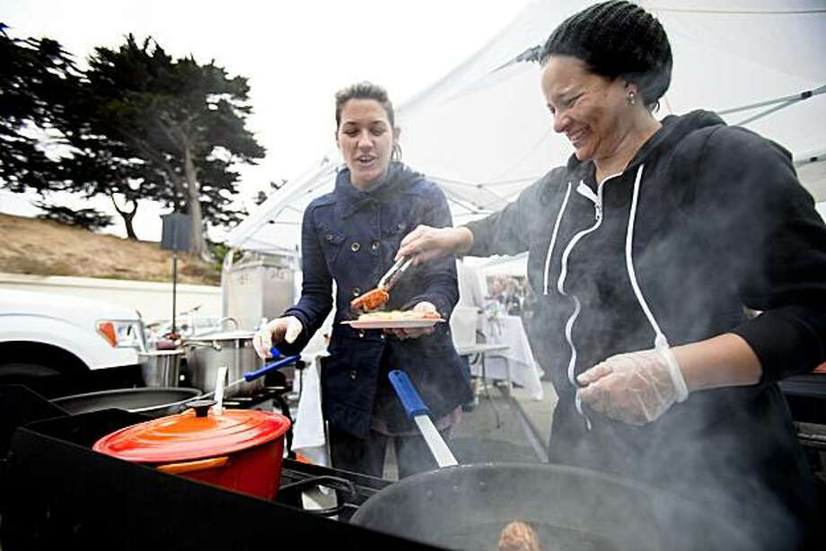 Christina Aviles assembles a shrimp toasties held by friend Libby Truesdell during the weekly Off The Grid food event held at Fort Mason Center in San Francisco, Calif. on Friday, Aug. 13, 2010. The food truck, started by Aviles and Aviles' partner Jessica Phadungsilp, specializes in variety of ethnic foods, from chicken curry to Thai spring rolls and banana coconut ice cream sandwiches. Photo: Stephen Lam, Special To The Chronicle