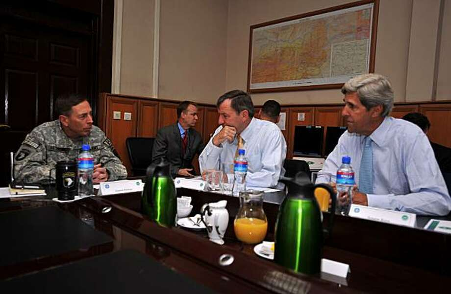 Sen John Kerry (D-MA), right, meets with General David Petraeus (left) and U.S. Ambassador to Afghanistan Karl W. Eikenberry at the U.S. Embassy in Afghanistan, August 17, 2010. Ten months after playing a pivotal role in persuading Karzai to agree to a runoff after a corruption-plagued presidential vote, Kerry returned with a firm new message: Karzai must allow the countryÕs new anti-corruption departments to do their job. (Daniel Wilkinson/U.S. Department of State/MCT) Photo: Daniel Wilkinson, MCT