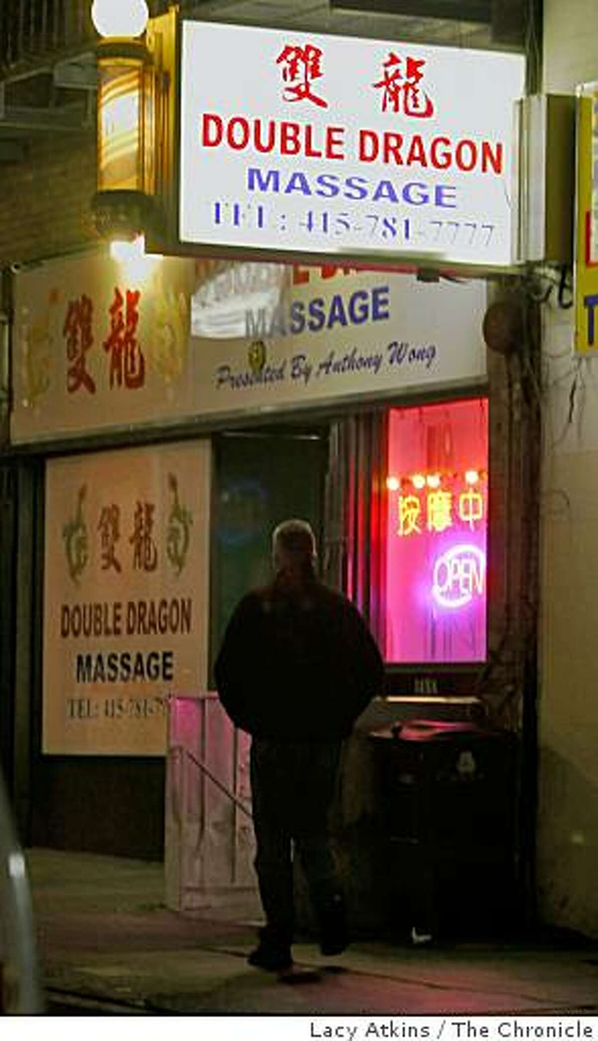 Under cover police offices first enter the Double Dragon Massage Parlor before the inspectors with the San Francisco Health Department enter on their surprise visits, Tuesday Nov. 25, 2008, in San Francisco, Calif. For the last two years the city of San Francisco has said it wants to crack down on brothels that front as massage parlors and parlors that have repeat health code violations. Yet city codes make it hard for the city to revoke illegal operators' licenses and the health department does not have enough staff to investigate the violations.