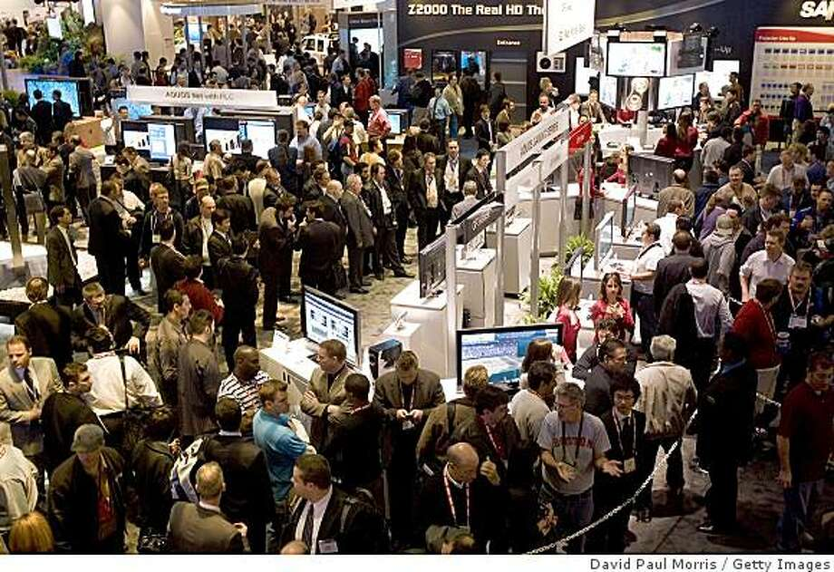 LAS VEGAS, NV - JANUARY 8:  Crowds of people are seen at the 2008 International Consumer Electronics Show at the Las Vegas Convention Center January 8, 2008 in Las Vegas, Nevada. CES, the world's largest annual consumer technology tradeshow, runs through January 10 and features 2,700 exhibitors showing off their latest products and services to more than 140,000 attendees.  (Photo by David Paul Morris/Getty Images) Photo: David Paul Morris, Getty Images