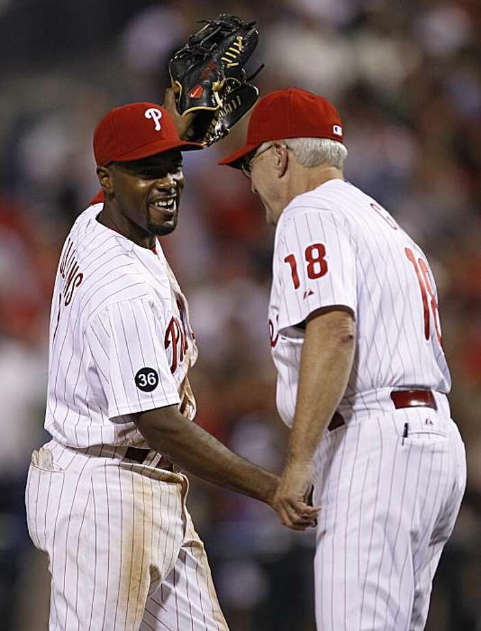 Philadelphia Phillies shortstop Jimmy Rollins, left, shakes hands with Phillies' coach Greg Gross after a baseball game against San Francisco Giants in Philadelphia, Wednesday, Aug. 18, 2010. The Phillies won 8-2. Photo: Matt Rourke, AP