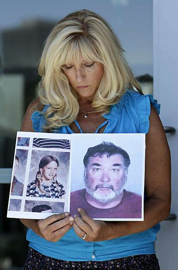 Teresa Rosson holds up photos of herself at age 11 and of Stephen Kiesle before a news conference in Oakland, Calif., Wednesday, Aug. 18, 2010. Rosson is one of the six women and one man who allege they were sexually abused by a Roman Catholic priest andhave filed two separate lawsuits against the Diocese of Oakland. The lawsuits filed Wednesday claim that the diocese was negligent in hiring and supervising Stephen Kiesle and failed to warn parents. Photo: Jeff Chiu, AP