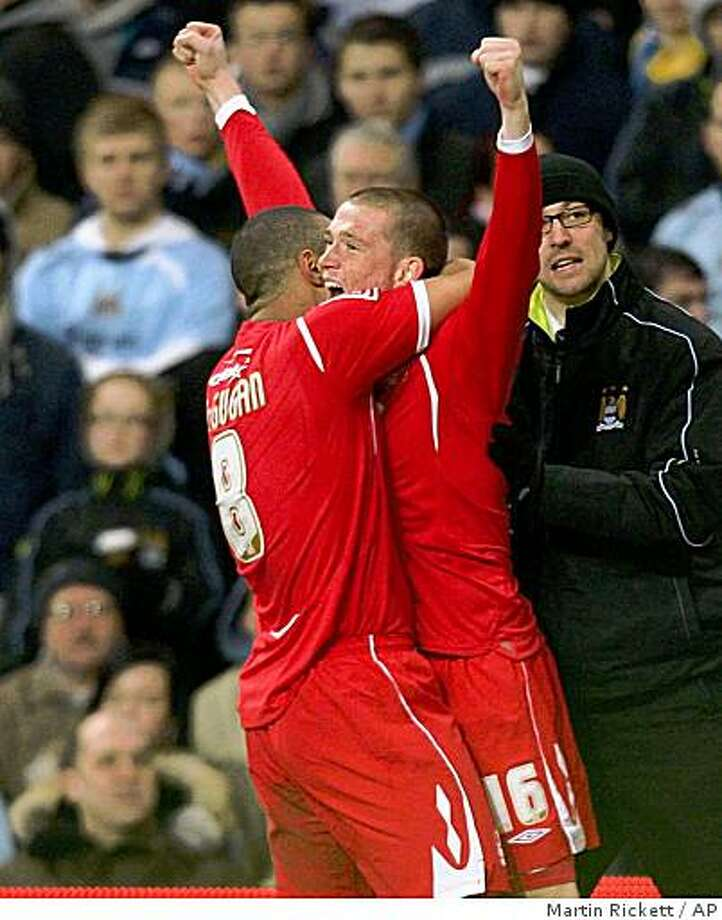 Nottingham Forest's Joe Garner, right, celebrates scoring against Manchester City with teammate Lewis McGugan during the English FA Cup third round soccer match at the City Of Manchester Stadium, Manchester, England, Saturday Jan. 3, 2009. Nottingham Forest won the match 3-0. (AP Photo/PA, Martin Rickett) ** UNITED KINGDOM OUT NO SALES NO ARCHIVE - NO INTERNET/MOBILE USAGE WITHOUT FOOTBALL ASSOCIATION PREMIER LEAGUE (FAPL) LICENCE. CALL  44 (0) 20 7864 9121 or EMAIL info@football-dataco.com FOR DETAILS ** Photo: Martin Rickett, AP