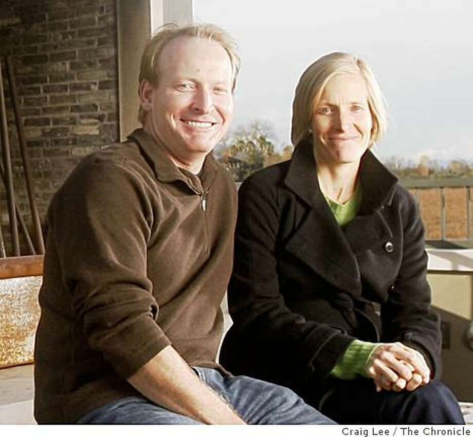 Ryan MacDonnell (right) and her brother, Miles MacDonnell (left), owners of Round Pond winery and olive oil production company in Rutherford, Calif., on December 23, 2008. They are sitting by the outdoor fireplace on the winery terrace over looking the vineyards. Photo: Craig Lee, The Chronicle