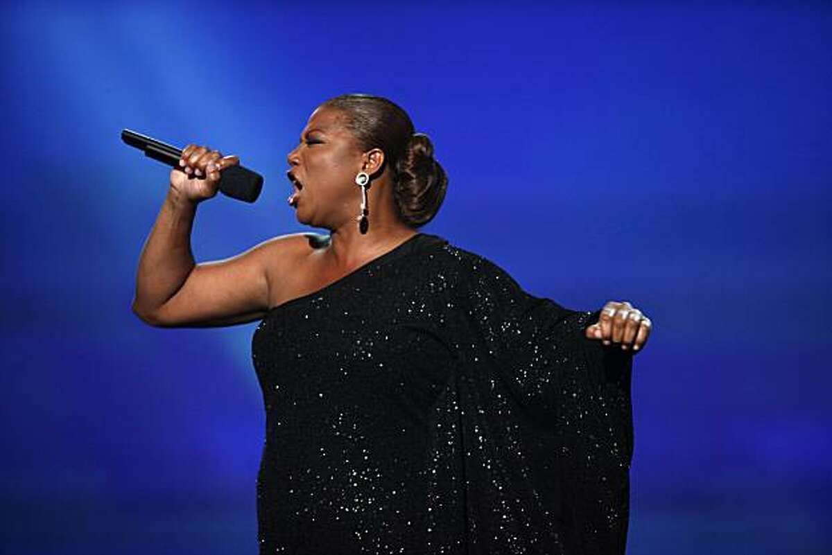 FILE - In this June 27, 2010 file photo, Queen Latifah performs onstage at the BET Awards in Los Angeles.